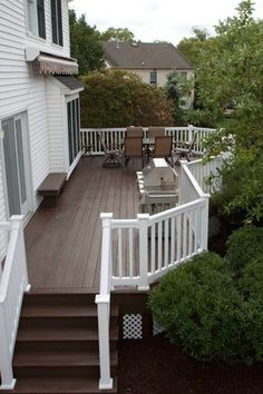 like the contrast between dark brown floor and white rails if we ever did a deck