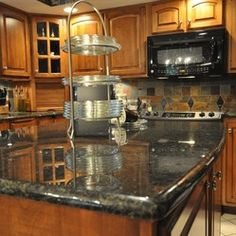 Kitchen Ideas Granite honey oak kitchen cabinets with black countertops |  pearl or