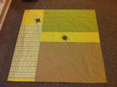 neutral quilt back, via Flickr.