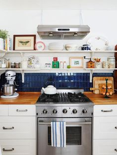 How to do open-shelves the right way #kitchen #hgtvmagazine // http://www.hgtv.com/design/rooms/kitchens/a-kitchen-with-shelves-and-shelves-of-personality?soc=pinterest