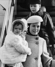 December 27, 1966: Princess Grace of Monaco, carrying her daughter, Princess Stephanie, and followed by her son, Prince Albert, arrives at Kennedy International Airport for a vi