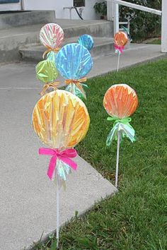 Lollipops in red and green...line the sidewalk as outdoor Christmas decorations?