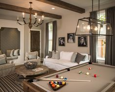 I LOVE this pool table/ living room set up