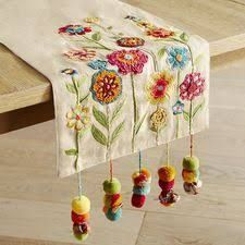 Table Runners : Table Linens - Something to cheer about: Our brightly colored table runner with embroidered and appliqued flowers, corded tassels and sprightly pompoms. Ribbon Embroidery, Embroidery Art, Embroidery Stitches, Embroidery Patterns, Diy And Crafts, Arts And Crafts, Table Runner Pattern, Needlework, Tassels