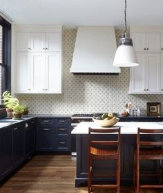 A Charming Brooklyn Heights Brownstone Decorated by McGrath II Black and white kitchen with wood floors, white upper cabinets, dark lower cabinets, industrial pendant lights and a marble countertops, tile backsplash - Painted Colorful Kitchen Cabinets Wood Floor Kitchen, Kitchen Flooring, New Kitchen, Kitchen Ideas, Kitchen Backsplash, Kitchen Paint, Kitchen Countertops, Backsplash Ideas, Backsplash Marble