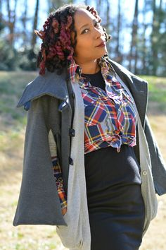 Thrift store style in a little black dress worn as a skirt with vintage plaid men's shirt. Layered with a cardigan and cape. All thrift store clothing.