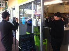 To portray local business in Salisbury we filmed a few scenes with Julio and Sarah at Coffee Amigo. Here Julio places a Council poster in the window of his shop advertising the coming Salisbury Writers Festival. Behind the scene fact: Julio is originally from El Salvador and has settled in Salisbury with his young family. He now has a successful business on John Street and was happy to help the council make their new film.