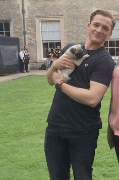 the two loves of my life: Taron Egerton, and pugs