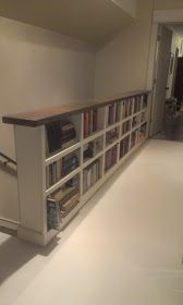 Instead of stair rail how about a bookcase?