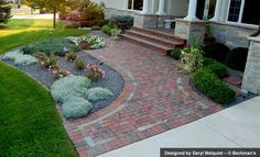 Clay paver walkway with contrasting inset and soldier course, clay pavers adhered to existing stoop.