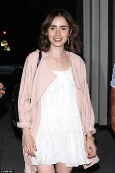 Snow White mini: Lily Collins proved herself to truly have fairy-tale good looks as she enjoyed a dinner at Catch LA in West Hollywood on Tuesday night