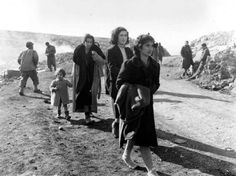 """""""Refugees on a mountain road in the Vallerotunda area, near Cassino, fleeing their town enveloped in battle, seeking safety behind the front."""" Vallerotonda, Italy. 7 February 1944"""