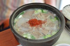 """As per custom when we have the gf's parents visit, we suggest the food and they make the final call. But today's lunch was a little more special. When living in Seoul in the 80s, her father would regularly come to this gisa sikdang (""""taxi restaurant"""") for this righteous bowl of seolleongtang (beef bone soup). He and his younger brother would come often and then fork over their hard-earned 4,000 won, which back then was considered pricey compared to its current 7,000 won price. While watching…"""