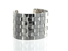 Looking for a great statement cuff? Look no further than the Textured Weave Cuff! This stunning cuff features a cool stacked weaved design in sterling silver. The amazing texture and polished silver make this piece stand out!