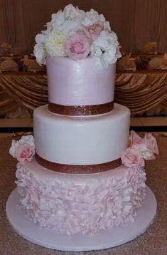Calumet Bakery Fondant Blush Wedding cake with Fondant Ruffle and Rose Gold Ribbon with fresh flowers.