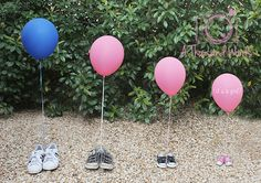 Cute gender reveal - this photo uses shoes and balloons to share the secret