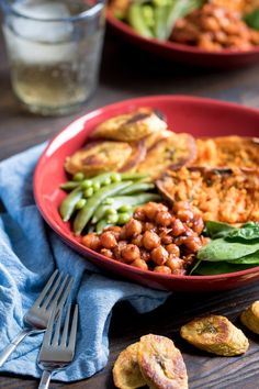 This Roasted Plantain + BBQ Chickpea Vegan Bowl recipe is the ultimate dinner idea that comes packed with a sweet + spicy side of chickpeas, fresh spinach, baked sweet potatoes, snow peas, and a twist of oven roasted sweet plantains. Pure perfection in one dish.