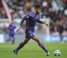 Cristiano Piccini of Fiorentina drives the ball during a match...