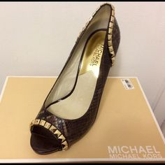 Gorgeous Michael Kors Pumps Brand New Michael Kors peep toe pumps. Absolutely gorgeous. Size 7.5. Gold stud details on  snakeskin like LEATHER material. Original price $198 Michael Kors Shoes Heels