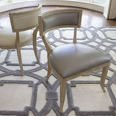 """This lovely side chair features a wood frame with a gray leather seat and back.  It looks great when paired with our Klismos Dining Table or with other similar transitional pieces or as a stand alone chair.  It measures 26""""W X 25"""" X 34""""H.  Click images for greater detail. If you are a qualified designer, please join our trade program!"""