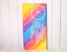 Whimsical Bohemian Dream Catcher Happy Home Decor Wall Painting. Sweet dreams are to be had when you hang this dream catcher painting above your bed. This acrylic painting features a white dream catcher against a kaleidoscope of yellow, orange, pink, purple, and blue hues. The soft white silhouette of the boho dream catcher offers comfort and is a gentle reminder that bad dreams are nothing more than wisps in the wind. They can do nothing to challenge the vibrancy and light within you…