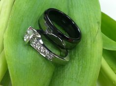 Bashoura, setting with Pave' diamonds with a black ceramic and tungsten mens wedding ring.