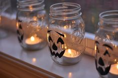 Mason jars + Jack'o'lantern faces = a fun way to bring some light to your mantle or window sill. Try these fun ones from Your Homebased Mom.
