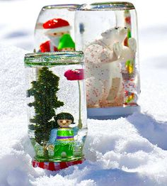 Make DIY snow globes by attaching toys to the inside of a jar lid. (What a perfect actvitiy for your child's next #snowday!)