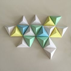 May 2017 - Fun geometric origami wall art tutorial. Origami Wall Art, Fabric Origami, Origami Paper, Paper Wall Art, Hanging Wall Art, Diy Wall Art, Origami Instructions, Origami Tutorial, Preschool Art Activities