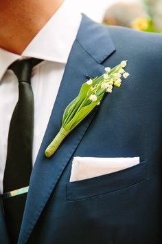 #Boutonniere | Sweet Lily of the Valley | Wedding on SMP - http://www.StyleMePretty.com/2014/01/09/colin-cowie-wedding-in-buttermilk-falls/ Tory Williams Photography |