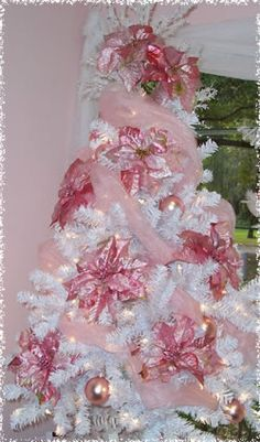 This is a Pink and White Christmas tree decorated with silk ponsettias and ribbon! It is a festive addition to the room! Pink Christmas Decorations, White Christmas Trees, Beautiful Christmas Trees, Holiday Tree, Christmas Love, Xmas Tree, Christmas Holidays, Christmas Mantles, Shabby Chic Christmas