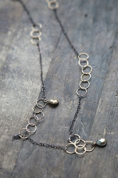 Mixed metals in blackened oxidized sterling and hand crafted loops of 14k gold fill link together to form an extra long chain that is perfect for