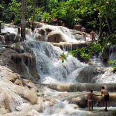 Dunns River Falls, in Ocho Rios, Jamaica. It's said that to climb to the top of the waterfall, linked hands with your loved ones will bring you luck.