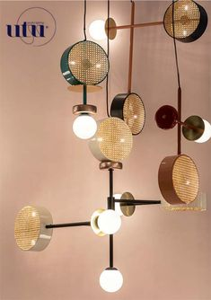 For Sale on - A perfect suspension of round shapes, rattan mesh and brass details intertwined with delicate and opaque glass globes.