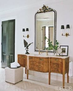 Powder Room - Re-purpose a sideboard as a beautiful vanity with marble counter top. Add a vintage framed mirror and 2 wall sconces and you have a highly original unique space. World Of Interiors, Home Luxury, Bathroom Vanity Designs, Bathroom Ideas, Vanity Bathroom, Antique Sideboard, Sideboard Decor, Mahogany Sideboard, Antique Buffet