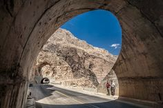 "500px / Photo ""Two Iranian men stand at edge of tunnel"" by Damon Lynch"