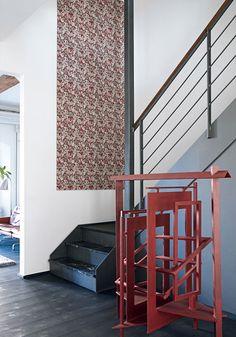 Nordic light minimalism interior design in a old Copenhagen apartment. Red sculpture by Danish artist Robert Jacobsens.