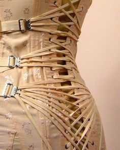 Corsets with fan lacing; also known as camp corsets were made so that it was possible for women to put on their corsets without the help of a maid.