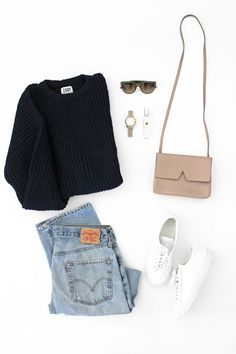 navy chunky sweater, Celine sunglasses, nude bag, Levi's jeans and white sneakers #style #fashion #fall #outfit