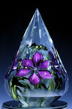 Encased 10 faceted floral paperweight with violet clematis in crystal.