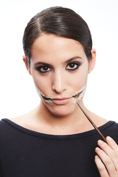 Extend the slit of the lips using a black eyeliner.                   Image Source: POPSUGAR Photography / ...
