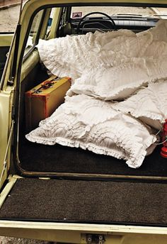 Throw a luxe quilt into a battered suitcase and off we fly!