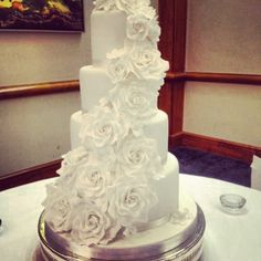 This is a four tier wedding cake.