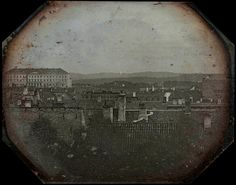 The first picture of Norway's capital Oslo is from 1840 and shows rooftops, 66 chimneys and the royal palace in the background without the central colonnade constructed yet.