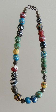 Necklace made up of a very nice group of Venetian glass trade beads with a few silver beads mixed in.  {750$}