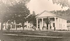 The first known photo of Wellsboro, PA includes the First National Bank and a residence. Both buildings are still located along Main Street, next to the Tioga County Courthouse.