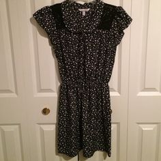 """""""So Hollywood"""" Black and White Stars Dress Peter Pan collar. Slightly puffed cap sleeves. Black lace panels in shoulders. Black and silver buttons. Elastic waist. Stars scattered all over with dots. Love this! Speechless Dresses"""