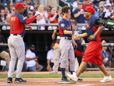 Ozzie Smith and Charlie McDermott celebrate a home run with Nelly at the 2014 MLB All-Star legends and celebrity softball game on July 13, 2014  http://www.gettyimages.com/detail/news-photo/ozzie-smith-charlie-mcdermott-celebrate-a-home-run-with-news-photo/452126182