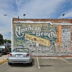 Awesome American Beauty Macaroni ghost sign in denver with another showing through from behind ... Cambell's maybe?