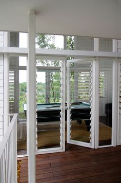 Breezway Louvres with glass blades let in the light and reduce the need for air conditioning.